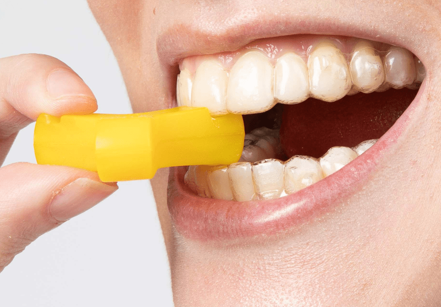Close-up of Yellow Munchie in mouth engaging with incisor